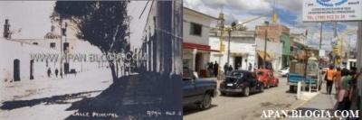 """Esta foto, en la que se lee la leyenda: """"Calle Principal"""", fue tomada en la esquina de Guerrero y Morelos, donde se alcanza a apreciar la cúpula y torre de la Iglesia, hoy cubiertas casi en su totalidad por los edificios, y por tratarse de calles céntricas, fue muy difícil tomar una foto sin tanta movilización, de ahí la cantidad de autos y gente."""